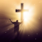 Good worship image. a-man-walking-towards-a-cross-with-sunbeams